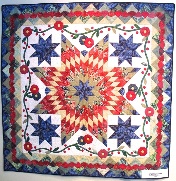 Star Medallion by Diana McClun and Laura Nownes, p. 86 of Quilts! Quilts!! Quilts!!! 3rd edition