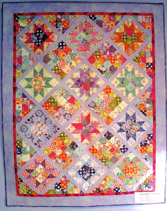 "Star Light, Star Bright by Diana McClun and Laura Nownes, quilted by Marla Monson, fabric 'Terrain"" by Kate Spain"