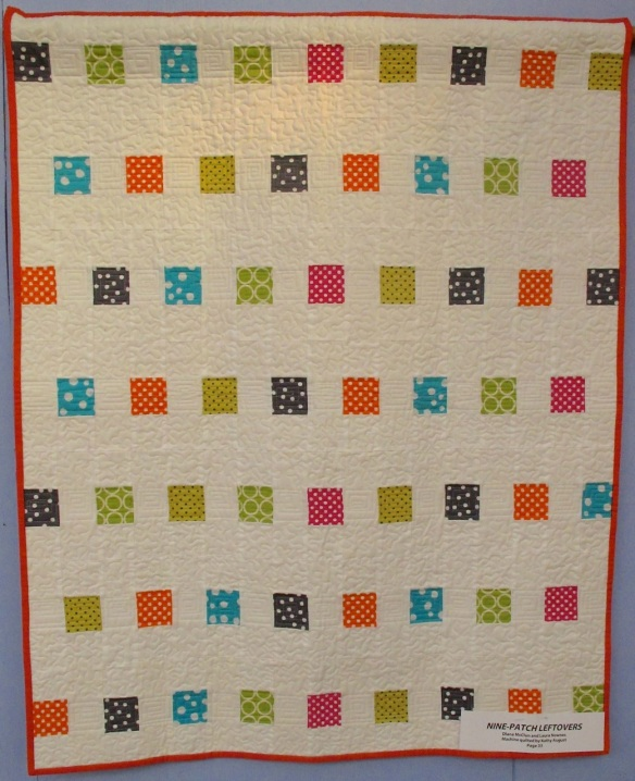 Nine-Patch Leftovers by Diana McClun and Laura Nownes, quilted by Kathy August, p. 33 of Quilts! Quilts!! Quilts!!! 3rd edition