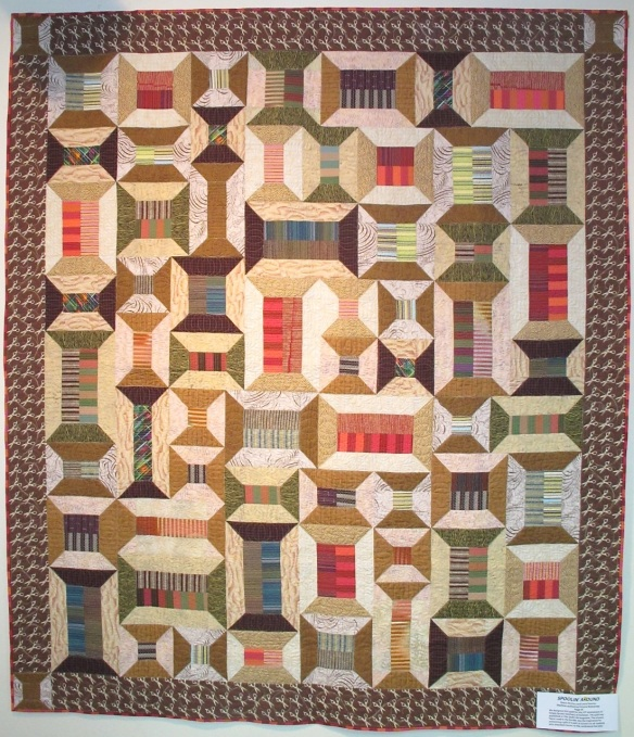 Spoolin' Around by Diana McClun and Laura Nownes, quilted by Victoria McEnerney, p. 59 of Quilts! Quilts!! Quilts!!! 3rd edition