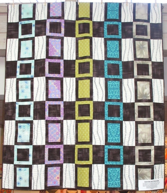 Square in a Square, by Diana McClun and Laura Nownes, quilted by Kathy August, p. 28 of Quilts! Quilts!! Quilts!!! 3rd edition