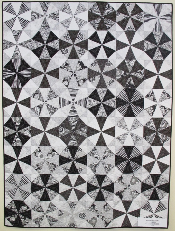 "Kaleidoscope by Dawn Guglielmino, quilted by Beth Hummel, fabrics ""licorice Fizz"" by Carol van Zandt, p. 54 of Quilts! Quilts!! Quilts!!! 3rd edition"