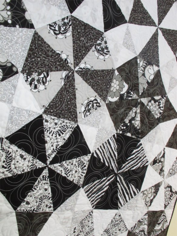 """Kaleidoscope by Dawn Guglielmino, quilted by Beth Hummel, fabrics """"licorice Fizz"""" by Carol van Zandt, p. 54 of Quilts! Quilts!! Quilts!!! 3rd edition"""