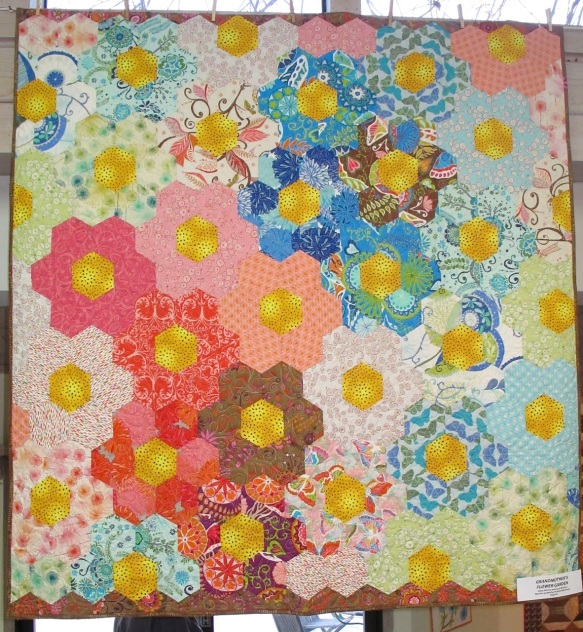 Grandmother's Flower Garden byMcClun and Laura Nownes, quilted by Victoria McEnerney with fabrics by Valori Wells, p. 64 in Quilts! Quilts!! Quilts!!! 3rd edition