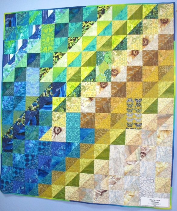 Half-Square Triangles by Diana McClun and Laura Nownes, p. 40 of Quilts! Quilts!! Quilts!!! 3rd edition