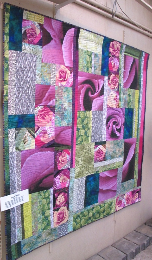 Lilac Rose by Diana McClun, for Kerby Smith, photographer of Quilts! Quilts!! Quilts!!! 3rd edition.  The lilac rose image is a photograph by Kerby Smith that he printed onto fabric.