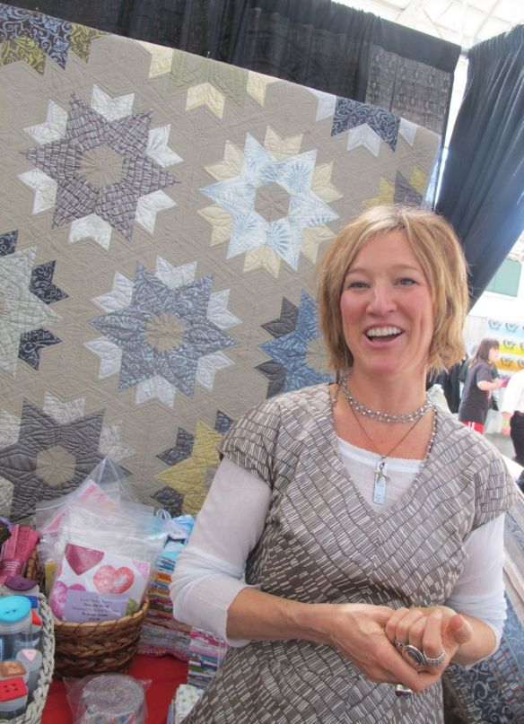 Jennifer Sampou in front of Daybreak Quilt by Jaybird Quilts using the Shimmer fabric collection by Jennifer Sampou for Robert Kaufman