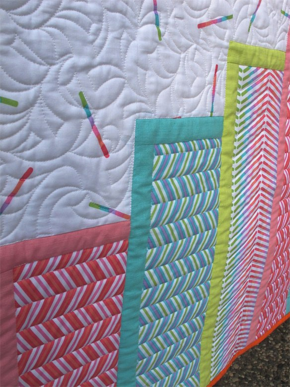"""Baby Rox Grow"" quilt pattern by Ann Haley, quilted by Angie Woolman using Pop Rox fabric by Carol Van Zandt for Andover fabrics"