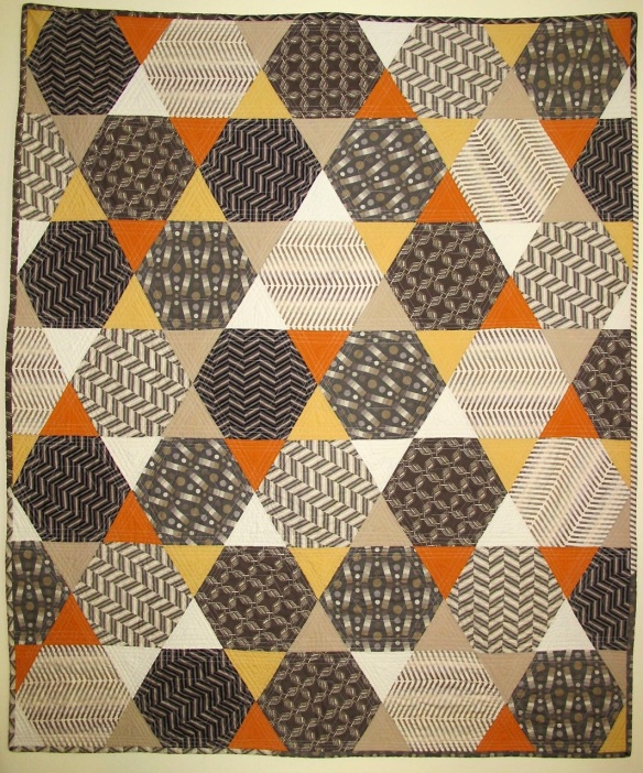 Hexagon quilt by margaret Glendening using Pop Rox fabric