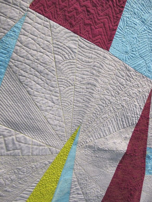"QuiltCon charity quilt, ""Temporal Shift"" by Essex County Modern Quilt Guild in Windsor, Ontario, Canada. Original design and quilting  by Adrian Hansen-Kelly, collaboratively pieced by the guild."