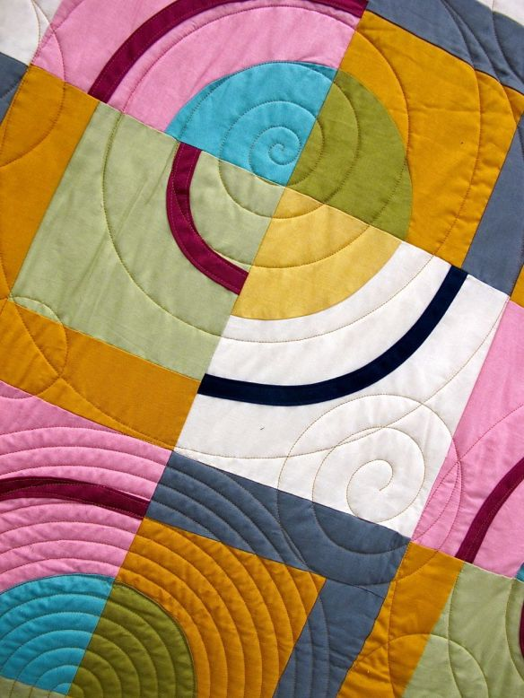 Orbits by Amy Stevenson. Ann Arbor, Michigan. Quilted by Kathy Koch of Thread Bear Quilting. Pattern available though Pink Castle Fabrics.