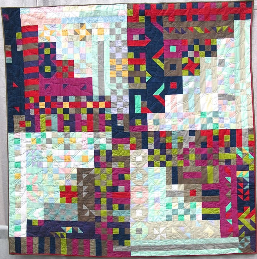 Propelled Pixels by Kim Lapacek. Poynette, Wisconsin. Quilted by Barbara Raisbeck.
