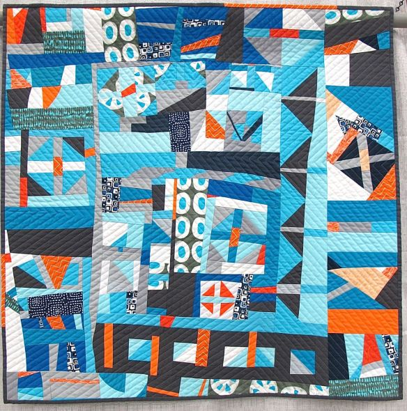 Churn Dash 2: Complementary by Martha Peterson. Woodinville, Washington. Pieced by Deborah Ferguson and Chandra Wu. 2nd place Group or Bee Quilts, QuiltCon 2015.