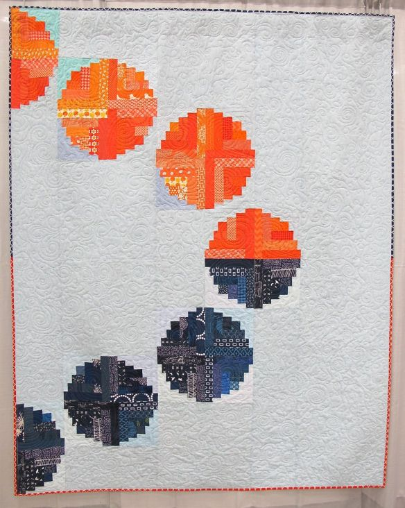 "Eclipse. Bellevue, Kentucky. Pieced by Hope Circle: Afton Warrick, Cath Hall, Christie Kline, Ellen McKee, Heather Pegel, Kim Soper, Kimberly Swick, Melanie Hughes, Suzy Lampman. Quilted by Ellen McKee. Use of curved blocks in spired by ""Log Cabin beads"" by Kathy Hamada."