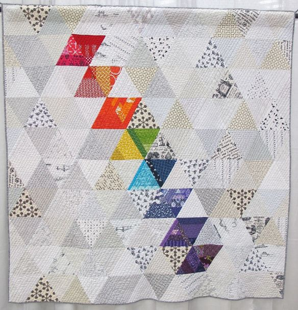 Rainbow Triangles. Silver Spring, Maryland. Pieced by Kat Drinkwater, Jennifer Ferriss-Salter, Mai Flourry, Briawna High,Lisa McGriff, Dhia Peach, Gabrielle Robles, Kari Stewart, Carla Voorhees, Jouise Wackerman. Quilted by Carla Voorhees.