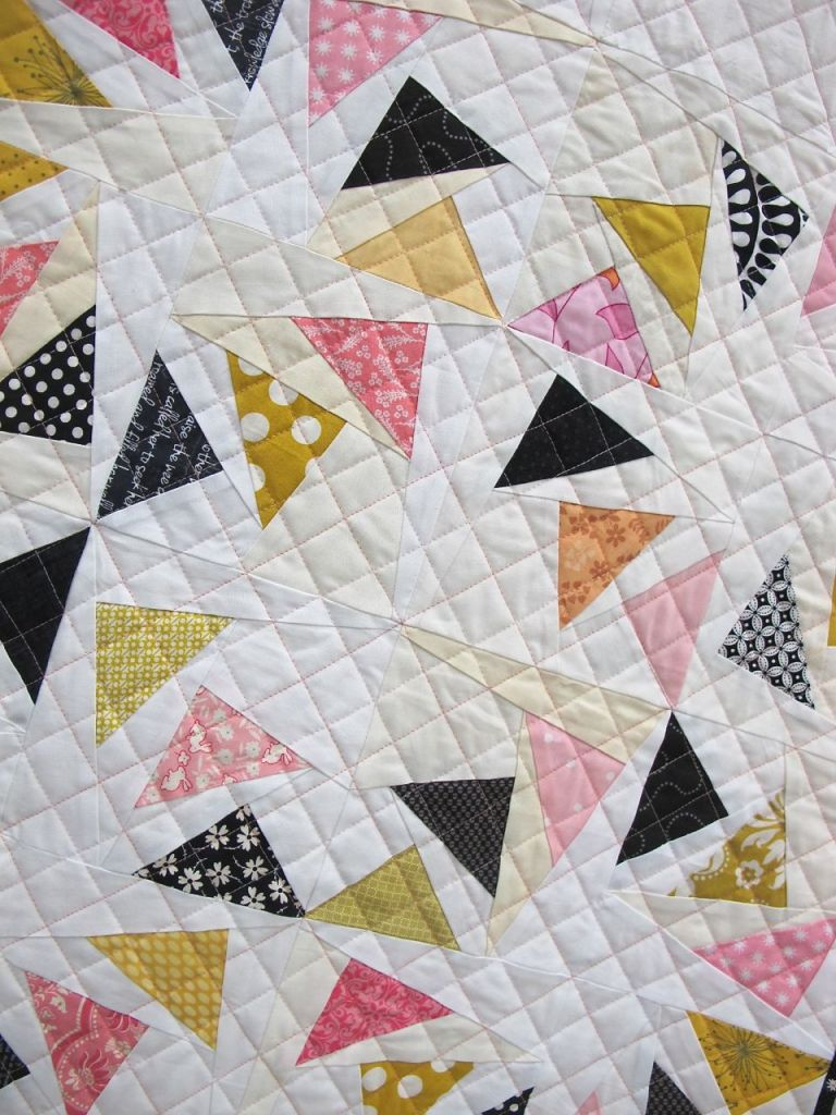 Geese in the Round. Raleigh, North Carolina. Pieced by kelleigh Bland, Kelly Cole, Erica Jackman, Stephanie Jacobson, Alyssa Lichner, Rene Martinez, Kristen Spears, Rebekah Thompson, Caitlin Topham, Lynn Wood. Quilted by Caitlin Topham. Design Source: Block pattern by Piece by Number, inspiration from Christina Lane of Sometimes Crafter.