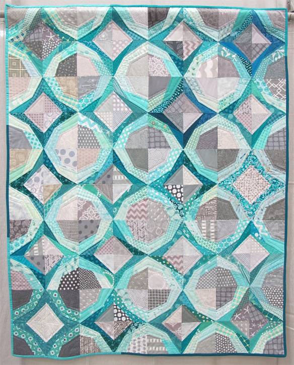 Icicles. Portland, Oregon. Pieced by Cath Hall, Ellen McKee, Suzy Lampman, Melanie Hughes, Nicole Boone, Kimberly Swink, Natalie, Weaver. Quilted by Cath Hall. Design Source: Paper piecing pattern Icky Thump by Julie Hirt of 627Handworks.