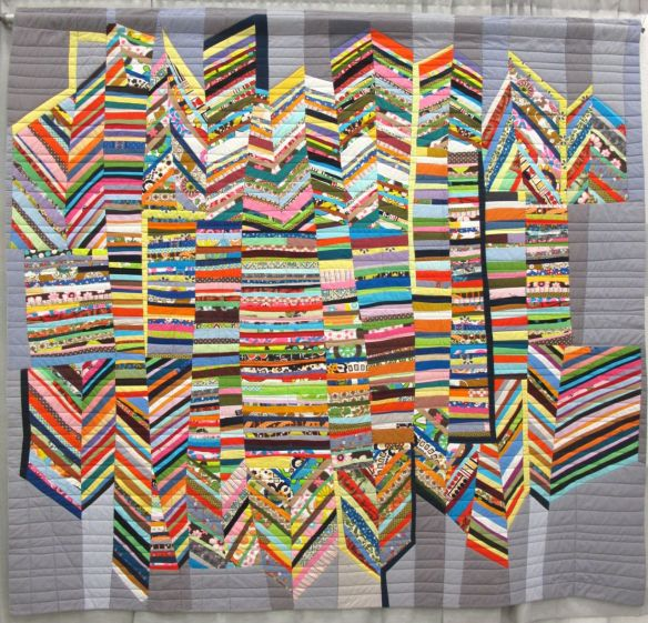 Score for Strings: City by Sherri Lynn Wood. Oakland, California. Quilted by Sue Fox.
