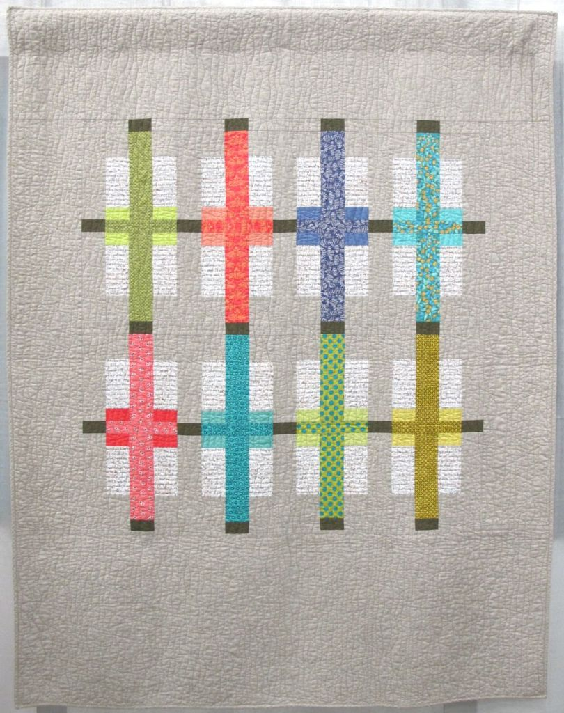 Color Play by Kari Vojtechovsky. Centennial, Colorado. Quilted by Susan Santistevan. 2nd Place, Use of Negative Space category, QuiltCon 2015.