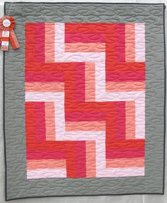 Rothko's Dream by Evie Guigley, Hernando Mississippi. Mom helped cut the rotary strips. Original design, 1st time using a long arm with instruction from Mrs. Teresa Pino, Quilts2aT Studio. 3rd Place, Youth Quilts, QuiltCon 2015.