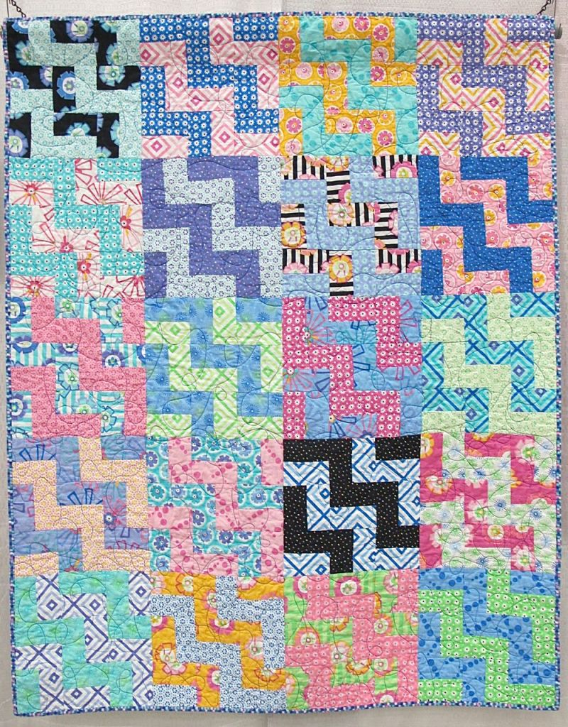 """Staircase by Kate Ivie, Austin, Texas. Pattern: """"Social Climber"""" from Villa Rosa Designs.Started at age 10. Quilted by Evie on a long-arm at The Cotton Cupboard in Lakeway, Texas. Binding by her mother, Jill Evie."""