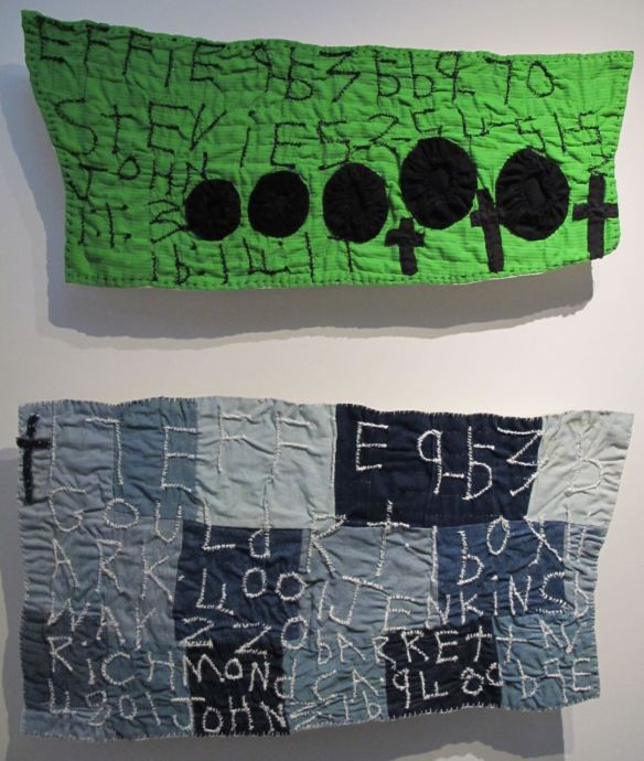 Black yo-yos on green hanging and 17 Patches. Pieced by Rosie Lee Tompkins, quilted by Irene Bankhead.Collection of Eli Leon