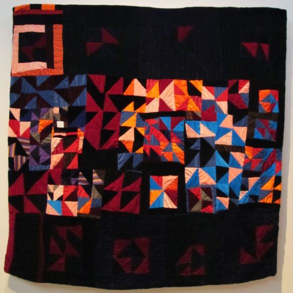 Four Patch Half Square Strip. Pieced by Rosie Lee Tompkins, quilted by Irene Bankhead.