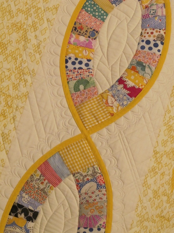 A Thousand Fibers Connects Us by Victoria Findlay Wolfe, quilted by Mandy Leins
