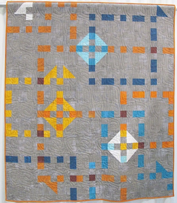Churn Dash Boogie-Woogie by Mickey Beebe, quilted by Toni McAuliffe