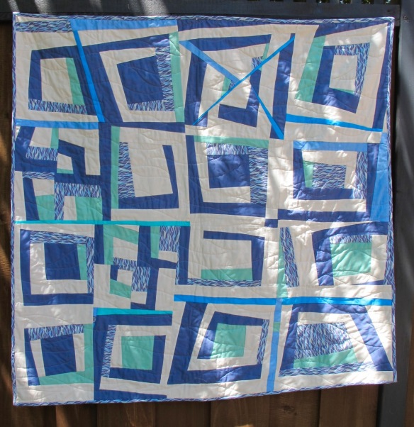 Untitled by Carol Van Zandt, started in a class by Stacey Sharman, http://www.peppermintpinwheels.com, quilted by Terri Carpenter of thequiltedfox.com