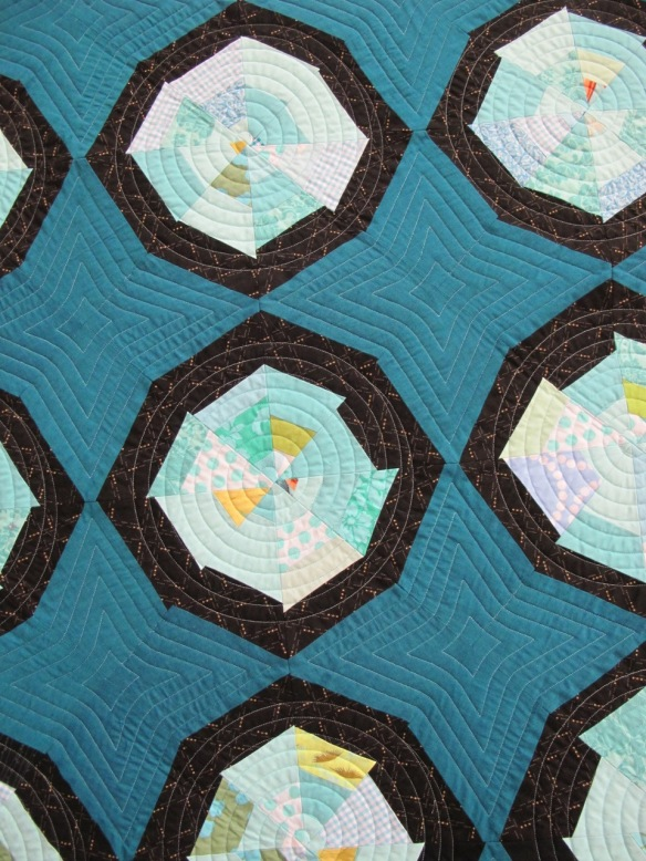 Blue Spiderweb by Leslie Schmidt, quilting by aaquilting.com