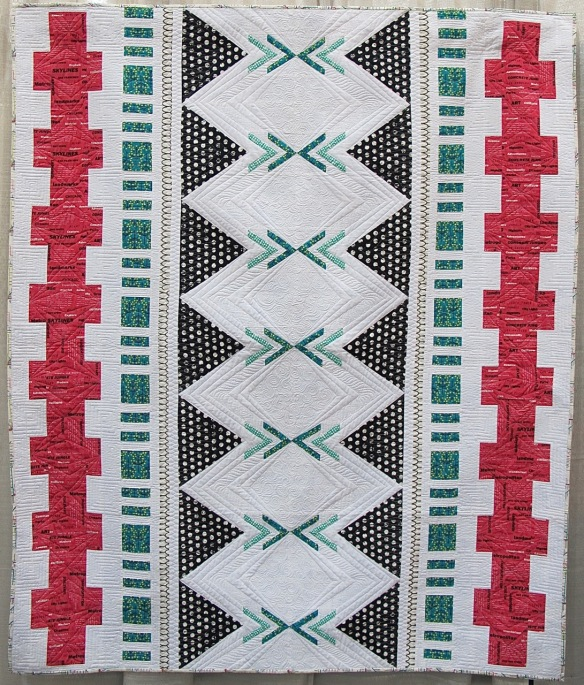Jungle Ave Tapa by Michelle Wilkie, quilted by Angela Walters