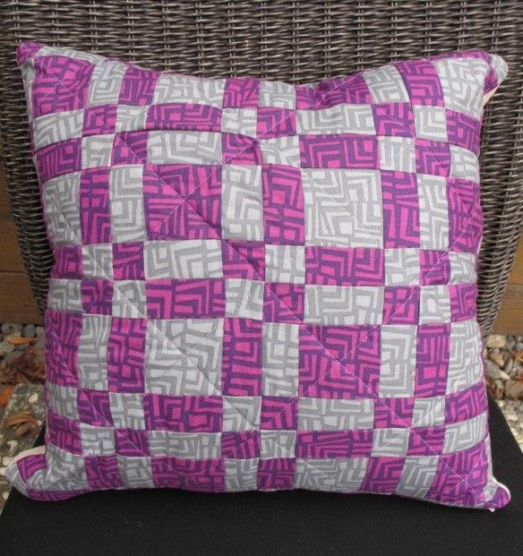Puss in the Corner block pillow by Anna Carloni