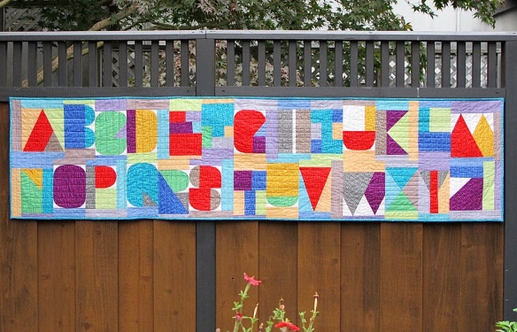 I Spy The Alphabet pattern by Terri Carpenter in a banner format sewn by Carol Van Zandt