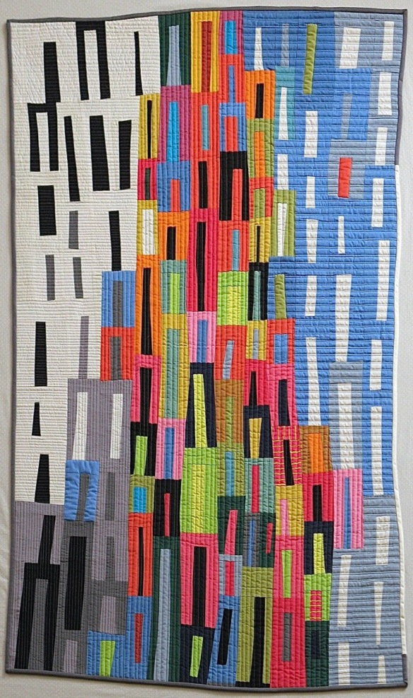 "Metropolis by Pam Rocco, quilted by Tami Levin. 40""x62"". 2015"