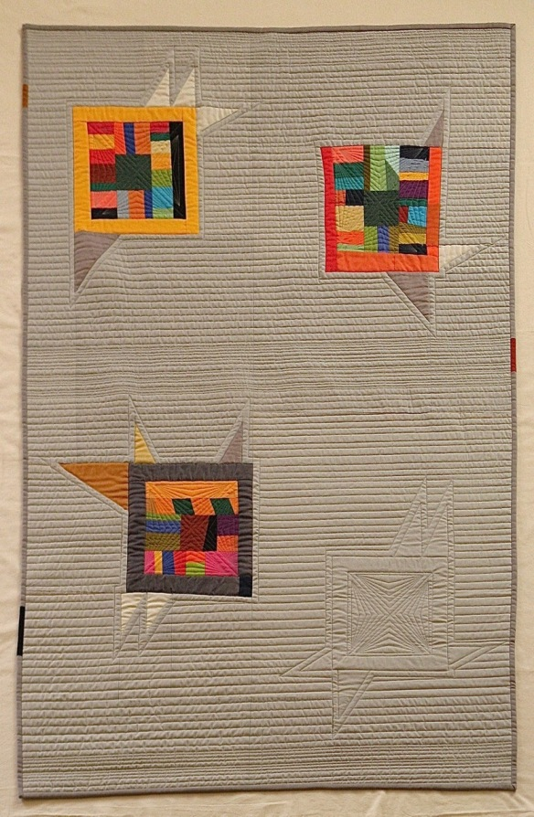 "Tumblebirds by Pam Rocco, quilted by Tami Levin 39"" x 66"". 2015"