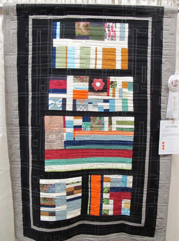 Not A Four Patch by John Maxwell, quilted by Sue Fox