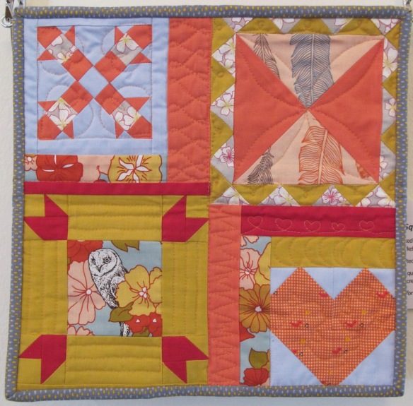 4 Square at the Shed by Mary Burnett and Kristen Takakuwa, quilted by Kristen Takakuwa