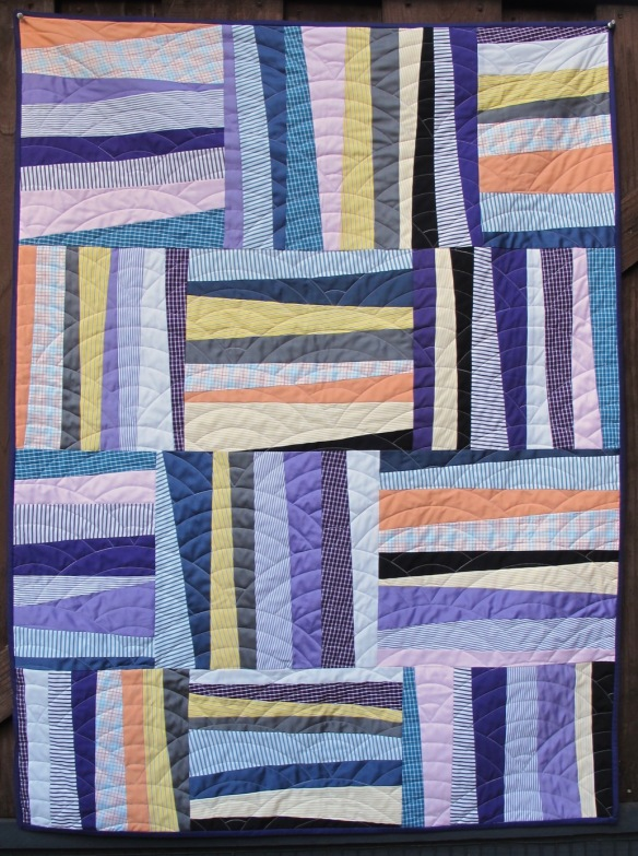 Shirt quilt by Carol Van Zandt. Quilting by Hello Stitch